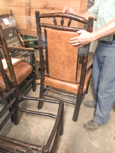 Hand-stretched and tacked premium top-grain leather seat and backing on this twig chair