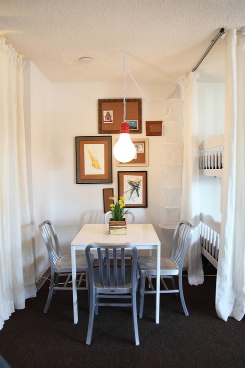 Separate your tiny homes' rooms with soft curtains