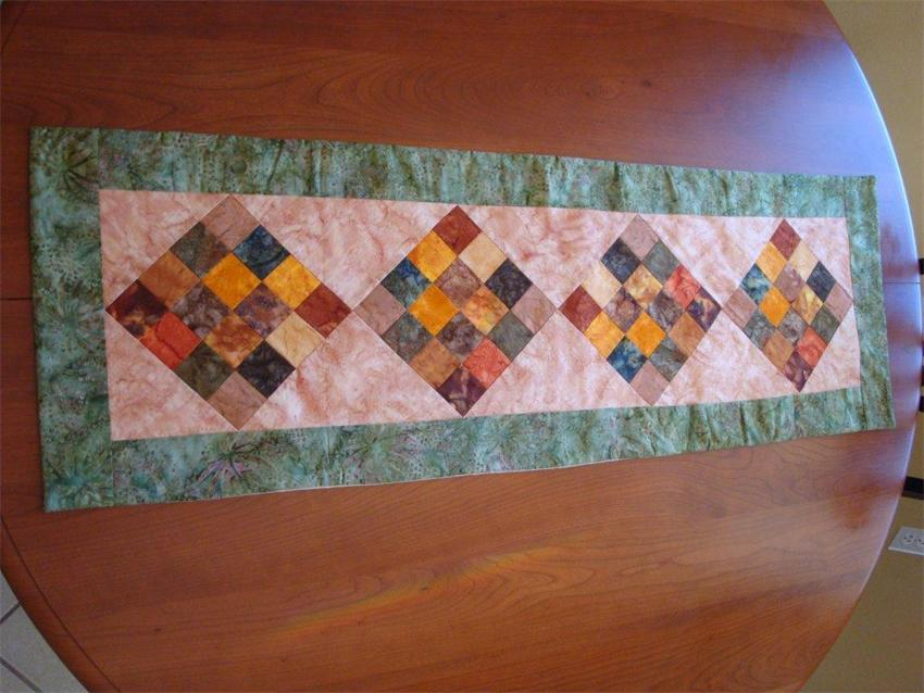 amish quilted block table runner with batik fabrics