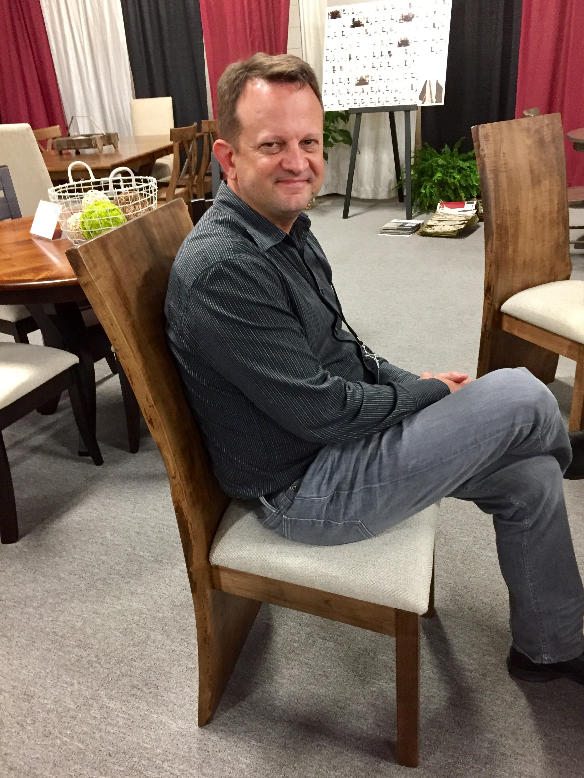 CEO Jim Miller testing out dining chairs