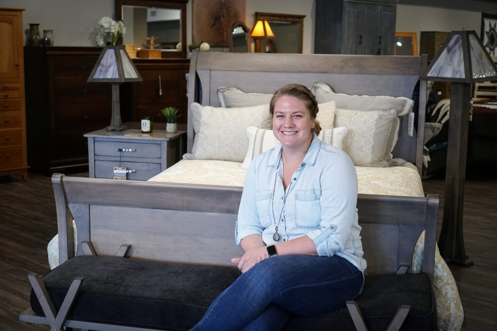 Mary Fehr with the Amish Transitions Sleigh Bed by Keystone