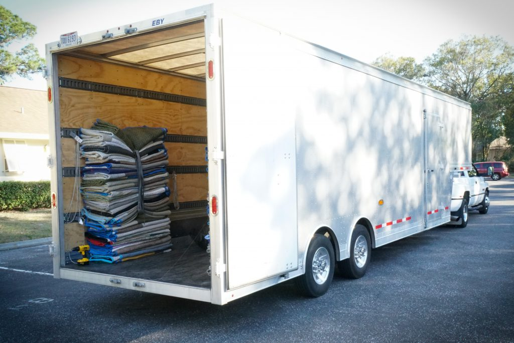 Padded moving blankets in the back of a truck