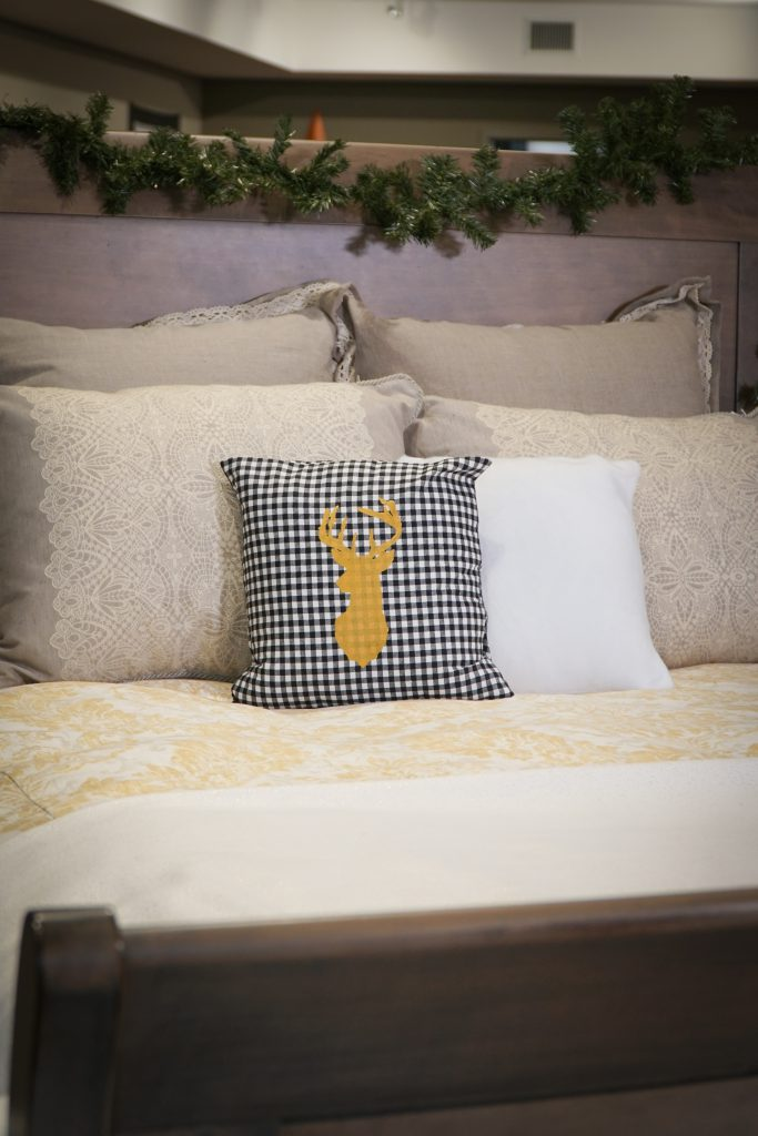 Transitions sleigh bed with garland and DIY pillow cases