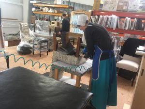 Working on upholstery at Genuine Oak Wooshop Ohio.