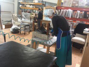 Working on upholstery at Genuine Oak Wooshop Ohio.