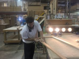 Hand sanding at MillCraft Woodshop.