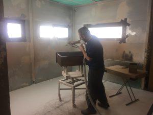 Applying finish at MillCraft Woodshop.
