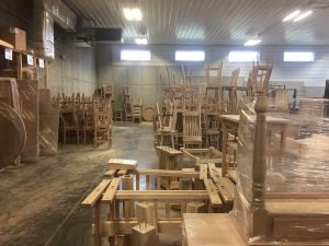 Unfinished furniture waiting for finish at Schlabach Finishing Shop.
