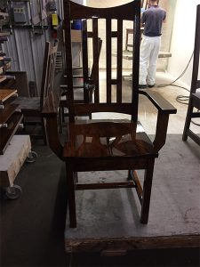 A chair with fresh finish applied.