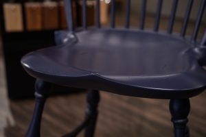 The saddle seat of the Amish Reproduction Windsor Bar Stool is scooped for comfort.