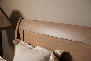 Light colored headboard with low sheen varnish.