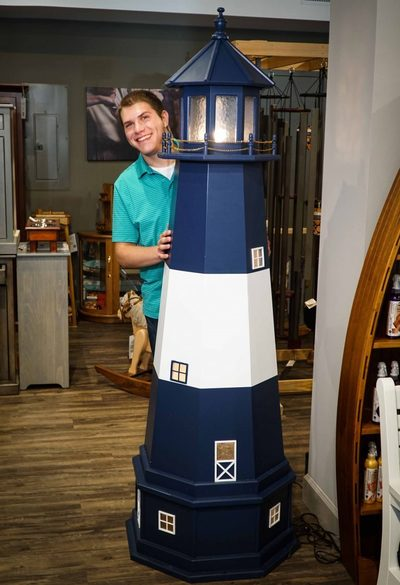 Ross with a lighthouse in the DutchCrafters Showroom