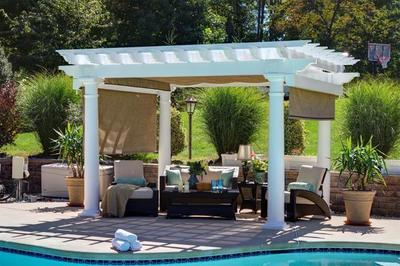 Amish Artisan Vinyl Pergola with shade curtains.