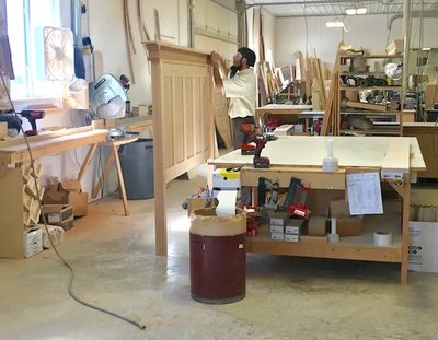 A woodworker in an Amish woodshop.