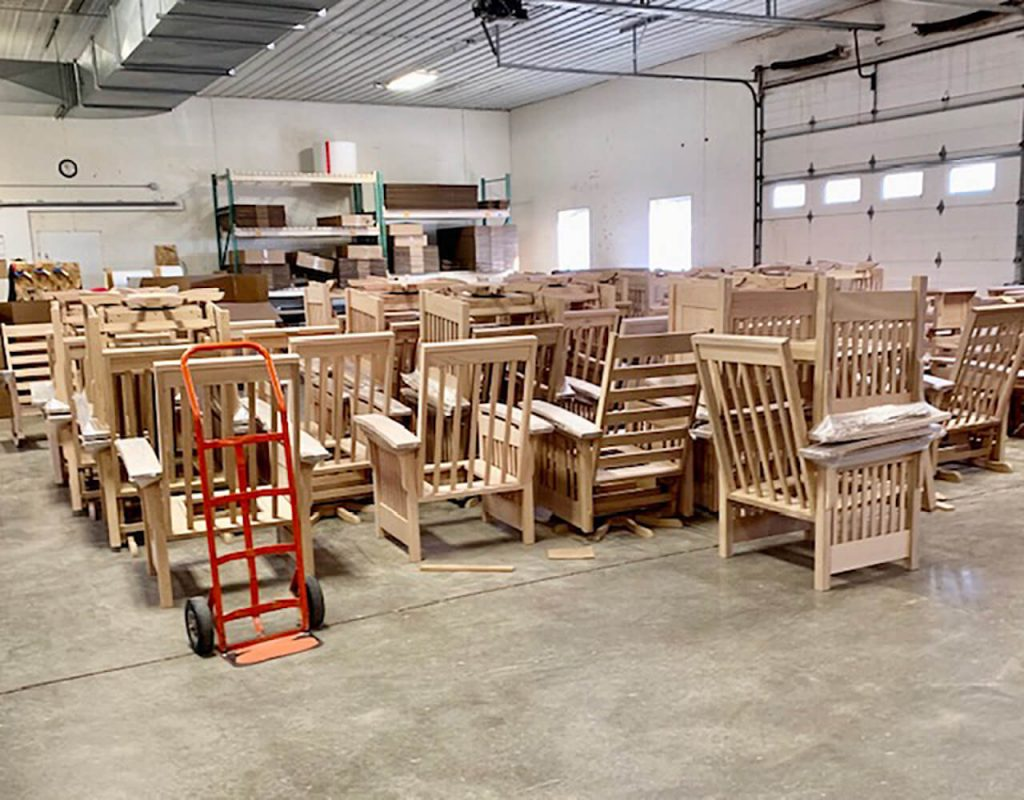 Solid wood chairs waiting for finish at an Amish wooshop.