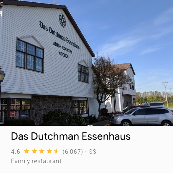 Front of Das Dutchman Essenhaus building from an angle with some cars parked in front