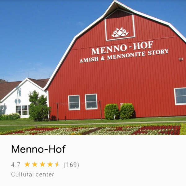 Photo of barn-looking building that houses the Menno-Hof, and Amish and Mennonite Information Center