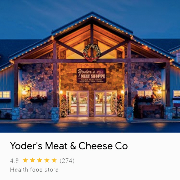 The front of the Yoder's Meat and Cheese Building decorate for Christmas