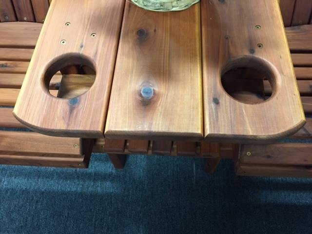 Natural streaks and knots on cedar wood chairs with attached table sample