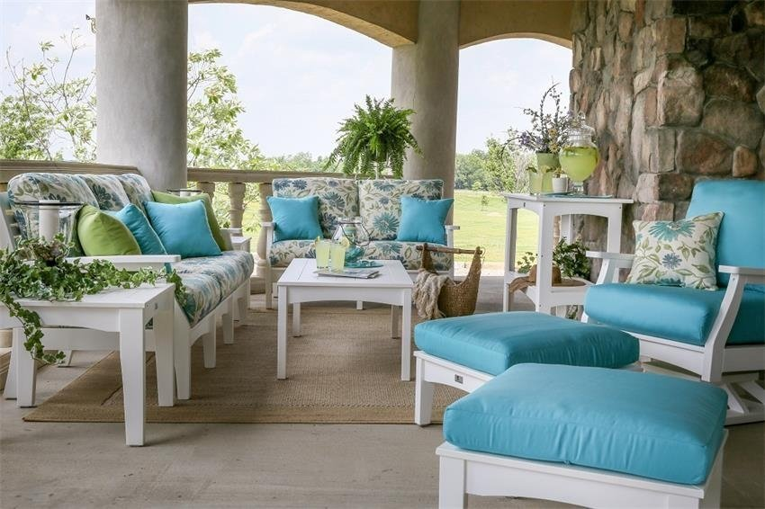 Pieces from the Berlin Gardens Classic Terrace Poly Outdoor Collection