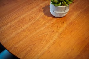 tabletop showing characteristics of cherry wood grain